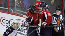 Washington Capitals' Nicklas Backstrom (19) celebrates his second period goal against Winnipeg Jets with teammate Alex Ovechkin as Jets' Jason Jaffray (41) skates past, during their NHL hockey game in Washington November 23, 2011. (MOLLY RILEY/REUTERS)