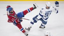 Montreal Canadiens' Rene Bourque, left, collides with Tampa Bay Lightning's Steven Stamkos during second period NHL Stanley Cup playoff action in Montreal, Sunday, April 20, 2014. (Graham Hughes/THE CANADIAN PRESS)