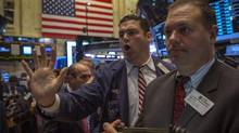 Traders work on the floor of the New York Stock Exchange, November 6, 2013. (BRENDAN MCDERMID/REUTERS)