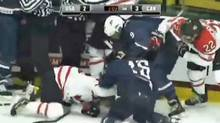 Team Canada and Team USA players scuffle late in the third period of their exhibition match in Vermont. (YouTube video still)