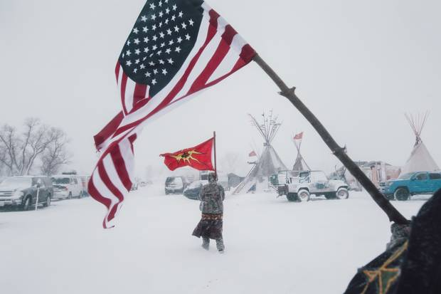 Canadian photojournalist Amber Bracken is recognized in contemporary issues category for her photo of protesters opposing the controversial Dakota Access Pipeline near the Standing Rock Sioux reservation. She has also won World Press Photo and International Picture of the Year awards for this work.