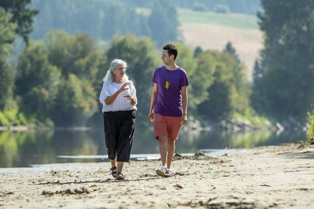 Rosalind Williams walks with her grandson Aaron Leon Williams along the shore line of the Shuswap River in Enderby, B.C. on Monday August 21, 2017.
