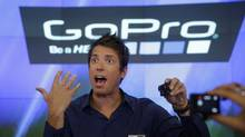 GoPro's CEO Nick Woodman is filmed by multiple GoPro cameras as he celebrates his company's IPO at the Nasdaq MarketSite in New York, Thursday, June 26, 2014. GoPro, the maker of wearable sports cameras, loved by mountain climbers, divers, surfers and other extreme sports fans, said late Wednesday it sold 17.8 million shares at $24 each in its initial public offering of stock. (Seth Wenig/AP)