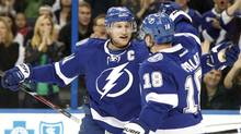 Tampa Bay Lightning center Steven Stamkos (91) is congratulated by left wing Ondrej Palat (18) after he scored a goal against the Vancouver Canucks  during the first period at Tampa Bay Times Forum. (USA TODAY Sports)