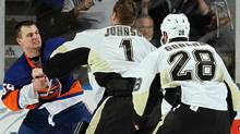 Penguins and Islanders brawl during the third period on February 11, 2011 at Nassau Coliseum in Uniondale, New York. . (Photo by Jim McIsaac/Getty Images) (Jim McIsaac/2011 Getty Images)
