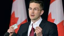 Minister of State (Democratic Reform) Pierre Poilievre speaks with the media following a decision by the Supreme Court on the Senate in Ottawa on Friday, April 25, 2014. (Adrian Wyld/THE CANADIAN PRESS)