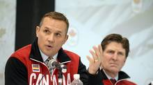 Canada's Men's Olympic Ice Hockey Team executive director Steve Yzerman (L) speaks as head coach Mike Babcock looks on, during a news conference in Toronto January 7, 2014. (AARON HARRIS/REUTERS)