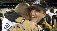 Hamilton Tiger Cats head coach Kent Austin and quarterback Henry Burris celebrate after they defeated the Toronto Argonauts in the CFL eastern final football game in Toronto, November 17, 2013.  (Reuters)