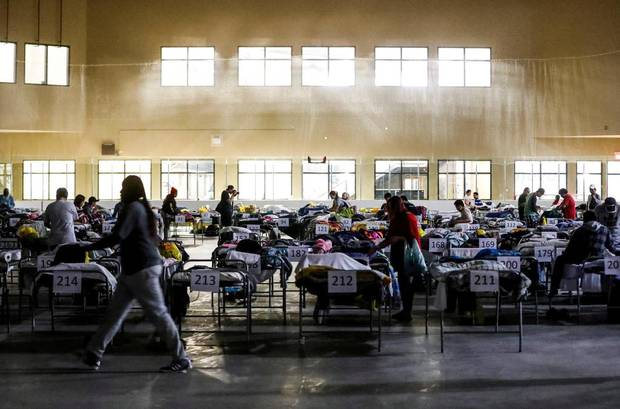 Evacuees from the wildfires use the sleeping room at the