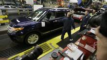 U.S. Ford workers are voting through next Tuesday on the proposed labour deal, which the company has said would improve its competitiveness in the United States as well as offer a fair deal for workers. (M. Spencer Green/Associated Press/M. Spencer Green/Associated Press)