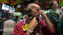 A trader works in the oil options pit at the New York Mercantile Exchange on July 3, 2013. Oil climbed above $101 (U.S.) a barrel as the political crisis in Egypt intensified. (Richard Drew/AP)