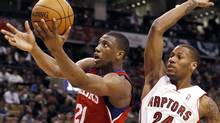 Philadelphia 76ers forward Thaddeus Young goes to the basket past Toronto Raptors forward Sonny Weems (R) during the second half of their NBA basketball game in Toronto March 7, 2010. REUTERS/Mike Cassese (MIKE CASSESE)