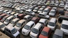 Cars are seen at a parking lot in Gurgaon, in the northern Indian state of Haryana. Auto manufacturing is just one of the global industries bullish on the future of business in India. (MANSI THAPLIYAL/MANSI THAPLIYAL/REUTERS)