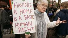 Sister Elizabeth Kelliher, a member of the Downtown Eastside Residents' Association, joins protesters outside a vacant hotel taken over by six squatters in Vancouver on Oct. 24, 2006. (CHUCK STOODY/THE CANADIAN PRESS)
