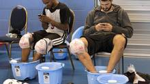 Toronto Raptors John Lucas III, left, and Linas Kleiza receive some ice therapy during training camp in Halifax, N.S. on Thursday, Oct. 4, 2012. (Andrew Vaughan/THE CANADIAN PRESS)