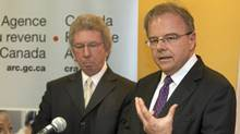 Revenue Minister Jean-Pierre Blackburn, left, and Patrice Chouinard, director of Montreal tax Services, speak to reporters at a news conference in Montreal on April 8, 2009. (Ryan Remiorz/Ryan Remiorz/The Canadian Press)