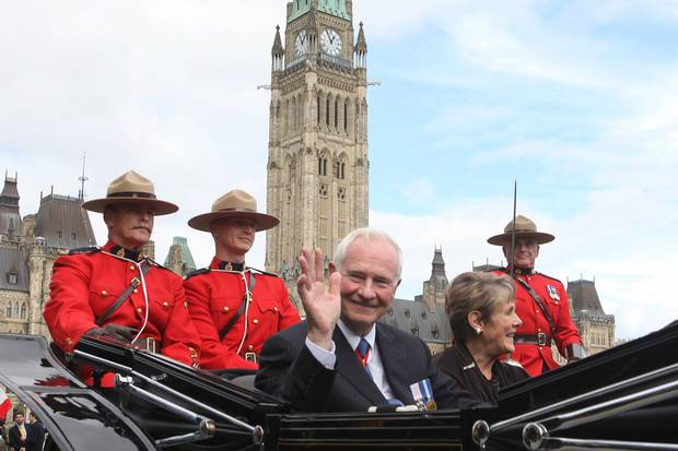 Oct. 1, 2010: Mr. Johnston waves as he leaves Parliament Hill with his wife following his installation ceremony.