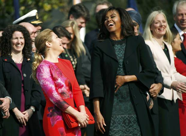 U.S. first lady Michelle Obama and Sophie Grégoire-Trudeau laugh at the official arrival ceremony at the White House in Washington.