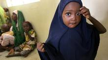 Niima Ahmed who is a polio sufferer stands as she and other polio suffering children wait to see a doctor at the General hospital in Kano, Nigeria, July 19, 2007. (George Osodi/AP)