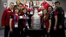Canadian Olympic athletes pose for a photograph with the Stanley Cup at Canada House at the 2014 Sochi Winter Olympics in Sochi, Russia on Monday, February 17, 2014. (Nathan Denette/THE CANADIAN PRESS)