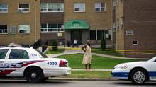Residents of the neighbourhood around Morningside Avenue and Danzig Street react the morning after a shooting at a backyard barbecue claimed the lives of a teenage girl and a man in his twenties (Galit Rodan/The Globe and Mail)