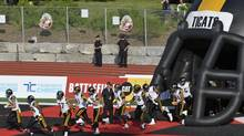 The Ticats take to the field during their first pre-season game against the Winnipeg Blue Bombers at the University of Guelph's Alumni stadium, June 20, 2013. (J.P. MOCZULSKI For The Globe and Mail)
