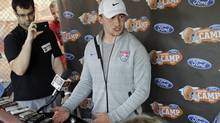 Cleveland Browns quarterback Johnny Manziel talks to reporters on the eve of the first practice at the NFL football team's training camp in Berea, Ohio Friday, July 25. (AP)