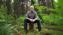 """Cariboo North MLA Bob Simpson sits on a log in Stanley Park in Vancouver June 6, 2012. Simpson was dubbed """"chicken little"""" when he first fretted about the future of the timber supply in his northern riding which was being devastated by the mountain pine beetle. (Jeff Vinnick For The Globe and Mail)"""