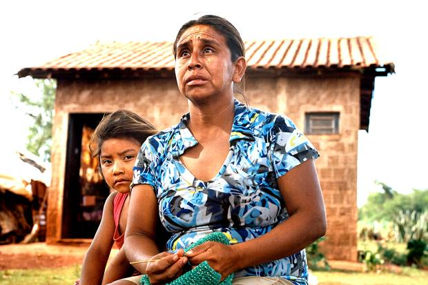 Mara Souza, shown with her daughter Lara in the Dourados Guarani-Kaiowa reservation in Brazil, is the ex-wife of Onildo de Oliveira, who died by suicide.