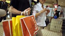 Shoppers carry bags through Toronto's Eaton centre May 30, 2010. (J.P. MOCZULSKI For The Globe and Mail)
