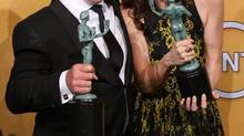 "Dean Norris, left and Betsy Brandt pose with their awards for outstanding performance by an ensemble in a drama series for ""Breaking Bad"" in the press room at the 20th annual Screen Actors Guild Awards at the Shrine Auditorium on Saturday, Jan. 18, 2014, in Los Angeles. (Matt Sayles/Invision/AP)"