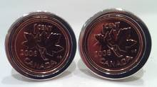 "A pair of penny cufflinks from reader Martin Traub-Werner. ""I wear 2006 on my left sleeve for my daughter and 2008 on my right sleeve for my son."""