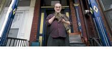 Reg Hartt, who runs The Cineforum, is photographed with his cat Berlin at his home in Toronto on Feb. 24, 2012. (Kevin Van Paassen/The Globe and Mail/Kevin Van Paassen/The Globe and Mail)
