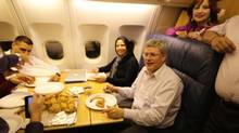 Stephen Harper enjoys samosas at 41,000 feet (Steven Chase)