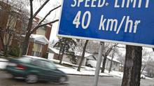 A lowered speed limit sign is shown in a neighboorhood of Edmonton. This is part of the pilot reduced speed-limit zones that have taken place in six neighboorhoods. (Jason Franson for The Globe and Mail./Jason Franson for The Globe and Mail.)