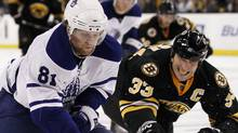 Toronto Maple Leafs right wing Phil Kessel (81) tries to get around Boston Bruins defenseman Zdeno Chara of Slovakia during the third period of Boston's 2-0 win in an NHL hockey game in Boston on Thursday, Oct. 28, 2010. (AP Photo/Winslow Townson) (Winslow Townson)