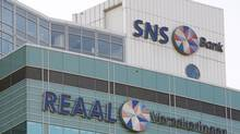 The logos of Dutch banking and insurance group SNS Reaal are seen in Utrecht in this file photo. (© Michael Kooren / Reuters/REUTERS)