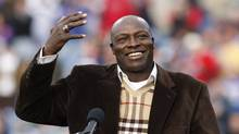 Former Buffalo Bills defensive end Bruce Smith smiling during his Hall of Fame ring ceremony at halftime of an NFL football game between the Bills and the Miami Dolphins in Orchard Park, N.Y., Nov.29, 2009. (Dean Duprey/AP/Dean Duprey/AP)