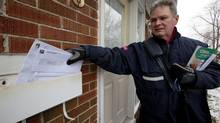 Mail carrier Leo Gaspari delivers mail on his route in the Don Mills and Lawrence area in Toronto on Dec. 11, 12013. Gaspari has worked for Canada Post for 33 years, 20 of which he has delivered mail. He will be retiring in two years but is worried about the pension trouble Canada Post is having. (DEBORAH BAIC/THE GLOBE AND MAIL)