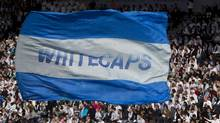 A giant Vancouver Whitecaps flag flies in the stands during the first half of an MLS soccer game against the Vancouver Whitecaps FC and the Toronto FC in Vancouver, March 19, 2011. (Jonathan Hayward/The Canadian Press/Jonathan Hayward/The Canadian Press)