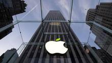 The leaf on the Apple symbol is tinted green at the Apple flagship store on 5th Ave in New York April 22, 2014. Employees and signage have been themed green to mark Earth Day. REUTERS/Brendan McDermid (© Brendan McDermid / Reuters)