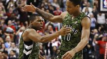 Toronto Raptors' Kyle Lowry celebrates his three point shot with DeMar DeRozan (Mark Blinch/THE CANADIAN PRESS)
