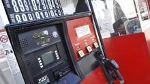 Gasoline prices are seen at the Lukoil gas station in South Plainfield, New Jersey September 12, 2012. (SHANNON STAPLETON/Reuters)