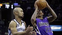Sacramento Kings' Isaiah Thomas (22) shoots over Memphis Grizzlies' Jerryd Bayless, left, during the first half of an NBA basketball game in Memphis, Tenn., Friday, Jan. 18, 2013. (Danny Johnston/AP)