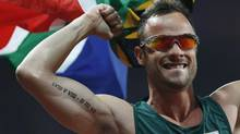 South Africa's Oscar Pistorius celebrates after winning the men's 400m - T44 final in the Olympic Stadium at the London 2012 Paralympic Games September 8, 2012. (SUZANNE PLUNKETT/REUTERS)