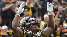 Hamilton Tiger-Cats defensive end Stevie Baggs celebrates after stopping the Montreal Alouettes inside the one yard line during the first half of their CFL football game in Hamilton September 5, 2011. (MIKE CASSESE/REUTERS)