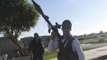 Free Syrian Army fighters carrying weapons are seen in the town of Ras al-Ain, near the province of Hasaka, 600 kilometres from Damascus, Dec. 5, 2012. Picture taken December 5. (Samer Abdullah/Shaam News Network/REUTERS)