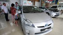 Toyota Motor Corp said on October 27, 2011 it would keep its Thai production suspended for a fourth week and reduce output in North America and South Africa, marking the first impact of the floods in Thailand on car production outside Asia. (CHAIWAT SUBPRASOM/REUTERS)