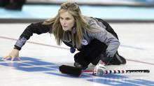 Canada's Jennifer Jones watches the rock after releasing it during the women's curling training session at the 2014 Winter Olympics, Sunday, Feb. 9, 2014, in Sochi, Russia. (Wong Maye-E/AP)