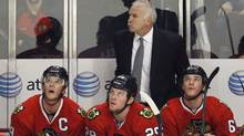 Chicago Blackhawks head coach Joel Quenneville stands behind center Jonathan Toews (L), Bryan Bickell (C) and Sean O'Donnell (R) as they look up at the clock in the final seconds of their season loss to the Phoenix Coyotes during Game 6 of their NHL Western Conference quarter-final hockey playoffs in Chicago, Illinois April 23, 2012. REUTERS/Chicago Blackhawks head coach Joel Quenneville stands behind center Jonathan Toews (L), Bryan Bickell (C) and Sean O'Donnell (R) as they look up at the clock in the final seconds of their season loss to the Phoenix Coyotes during Game 6 of their NHL Western Conference quarter-final hockey playoffs in Chicago, Illinois April 23, 2012. REUTERS/Jim Young (Jim Young/Reuters)